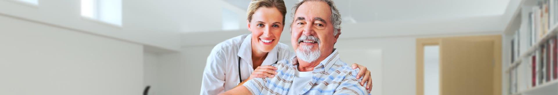 senior patient and caregiver smiling