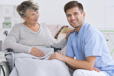 senior women and caregiver smiling