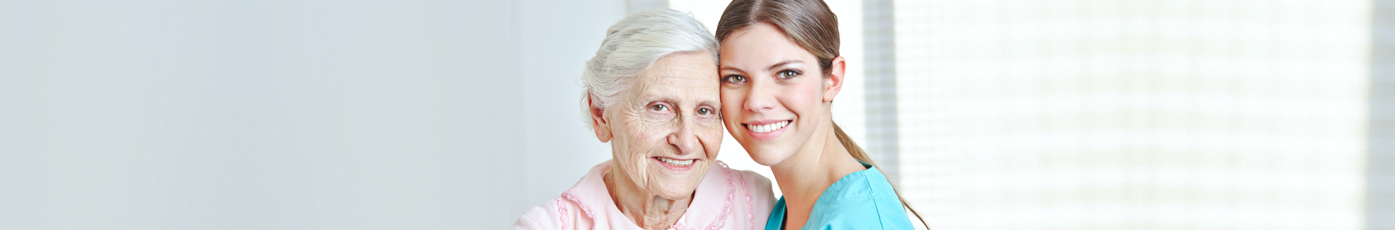 senior and caregiver smiling